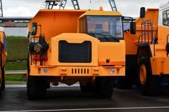 Low yellow dump truck for transportation of rock mass and minerals in underground workings, tunnels and other cramped conditions. Special equipment. Mining stock photography