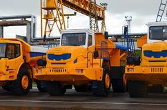 Low yellow dump truck for transportation of rock mass and minerals in underground workings, tunnels and other cramped conditions. Special equipment. Mining stock photo