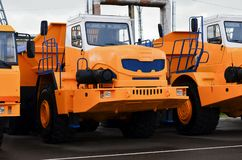 Low yellow dump truck for transportation of rock mass and minerals in underground workings, tunnels and other cramped conditions. Special equipment. Mining stock image
