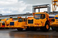 Low yellow dump truck for transportation of rock mass and minerals in underground workings, tunnels and other cramped conditions. Special equipment. Mining stock images
