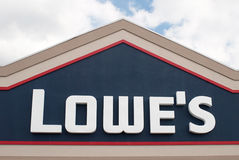 Lowe's Sign. DAYTON, OHIO, USA – AUGUST 25: Lowe's sign on its home improvement storefront stands against blue sky with clouds in Dayton, Ohio on August 25 Royalty Free Stock Photo