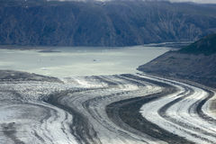 Lowell Glacier and Lake, Kluane National Park, Yukon. The Lowell Glacier in Kluane National Park, Yukon Territory, as it empties into a lake Royalty Free Stock Photos