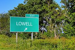US Highway Exit Sign for Lowell. Lowell US Style Highway / Motorway Exit Sign stock photography