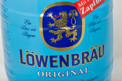 Lowenbrau small barrel of beer can closeup against white. Lowenbrau is a brewery founded in Munich around 1383, its name means lion`s brew in German Stock Photo