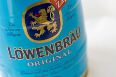 Lowenbrau small barrel of beer can closeup against white. With copy space. Lowenbrau is a brewery founded in Munich around 1383, its name means lion`s brew in Royalty Free Stock Photography