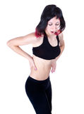 Lower back pain. Woman has a Lower back pain, isolated in white Stock Image