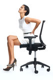 Lower back pain. Businesswoman with lower back pain from sitting on office chair stock photo