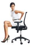 Lower back pain. Businesswoman with lower back pain from sitting on office chair royalty free stock photography