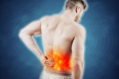 Lower back pain. Concept picture of a man with lower back pain Stock Photos