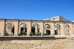 Lower Barraka Gardens arches, Valletta. Tourists looking at the view through arches in Lower Barrakka gardens, Valletta, Malta, Europe Royalty Free Stock Photos