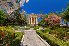 Lower Barrakka Gardens, Valletta, capital of Malta. Blossoming spring Lower Barrakka Gardens and monument dedicated to Alexander Ball in the old town Valletta Stock Photo