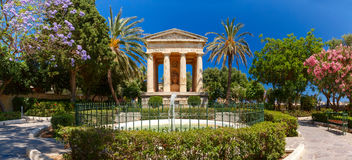Lower Barrakka Gardens, Valletta, capital of Malta. Panorama of blossoming spring Lower Barrakka Gardens and monument dedicated to Alexander Ball in the old town Stock Photos
