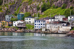 Lower Battery, St. John's, Newfoundland. Colorful houses on the rocky shore of Signal Hill facing the harbour in St. John's, Newfoundland, Canada. A section of Stock Photo