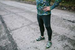Lower body of fit runner with hands on hips Stock Photo