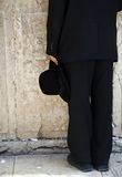 Holding a Hat by the Wailing Wall Stock Photo