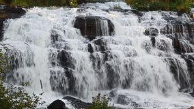 Lower Bond Falls Loop. Bond Falls, a remarkably beautiful waterfall in Michigan's remote Upper Peninsula near Paulding, splashes down with whitewater cascading stock video