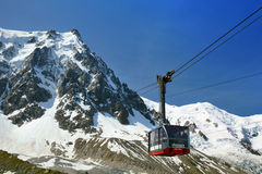 The lower cabin of Aiguille du Midi cable car, Chamonix. CHAMONIX, FRANCE - JULY 03, 2014: The lower cabin of Aiguille du Midi cable car against summer valley Stock Image