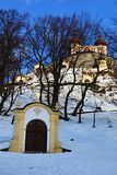 Lower chapels of Banska Stiavnica calvary during winter season in march 2018, upper church in background, snowy sunny day. Clear blue skies royalty free stock images