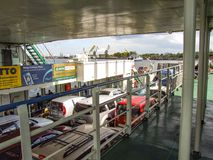Lower deck of Bielik ferry transporting cars and passengers between Wolin and Uznam islands in Poland. Over Swina river in city of Swinoujscie. In background Stock Images