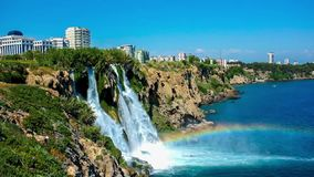 Lower Duden Falls in Antalya. The magnificent Lower Duden Falls surrounded by tall rocky cliff and drop into Mediterranean sea with great noise, spray and foam stock footage