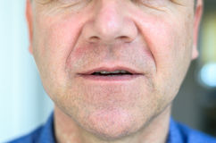 Lower face of a middle aged with lips ajar Stock Photo