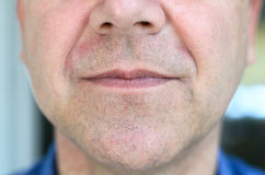 Lower face of a middle aged with lips ajar Stock Image