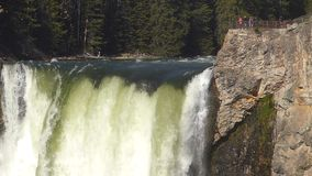 Lower Falls with people on a viewing platform in Yellowstone National Park, Wyoming, USA stock video