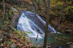 Lower Falls on Roaring Run Creek, Jefferson National Forest, USA. An autumn view of the lower falls on Roaring Run Creek is located in Roaring Run Recreational royalty free stock photo