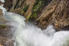 Lower falls Yellowstone river. Raging waters. Spray from waterfall. Lower falls Yellowstone river. Raging waters. Spray from waterfall Stock Images