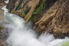 Lower falls Yellowstone river. Raging waters. Spray from waterfall. Stock Photo