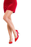 Lower half of girl in red skirt and heels Stock Images