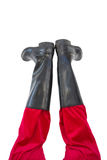 Lower half of santas legs with his black boots Royalty Free Stock Photography
