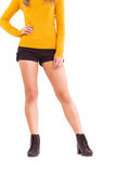 Lower half of woman in boots and shorts Stock Image