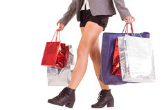 Lower half of woman with shopping bags Royalty Free Stock Image