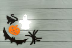 Lower left corner frame of halloween paper silhouettes. Lower left corner frame of halloween with pumpkin, ghost, bat, spider and cat paper silhouettes on a gray Stock Images