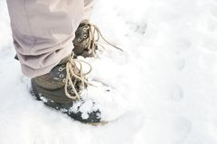 Person legs standing snow with boots and insulated pants Royalty Free Stock Image