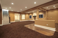 Lower level basement. In earth tones and marble fireplace Royalty Free Stock Images