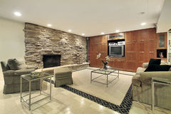Lower level with stone fireplace Royalty Free Stock Images