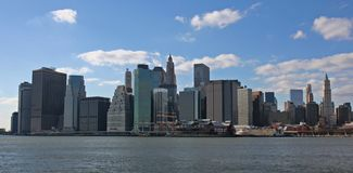 Lower Manhattan. With blue sky and clouds Stock Image