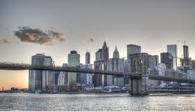 Lower Manhattan with Brooklym Bridge at sunset Royalty Free Stock Image