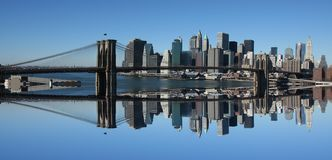 Lower Manhattan and Brooklyn Bridge. Panoramic with reflection Stock Photography