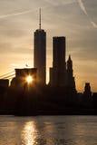 Lower Manhattan and Brooklyn bridge in New York at sunset - USA Stock Photo