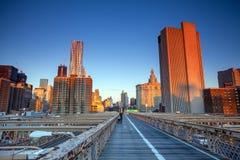Lower Manhattan through Brooklyn Bridge at sunset, New York City Stock Photos