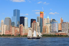 Lower Manhattan cityscape with sailing ship, New York, USA Royalty Free Stock Images