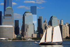 Lower Manhattan cityscape with sailing ship, New York, USA Stock Images