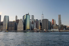 The lower Manhattan and Financial District of New York City just. As twilight starts and the office lights begin to come one Royalty Free Stock Photography