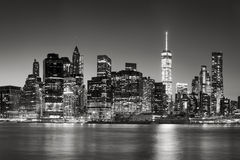 Lower Manhattan Financial District skyline at dusk, New York City. Black & White East River view of Financial District skyscrapers at dusk. Lower Manhattan Stock Photos