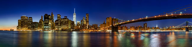 Lower Manhattan Financial District skyscrapers at twilight. New York City. Panoramic view of Lower Manhattan Financial District skyscrapers at twilight with the Stock Photos