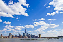 Lower Manhattan in front of beautiful sky Royalty Free Stock Images