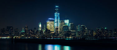 Lower Manhattan from Hudson river at night Stock Photography